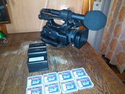 Продам профессиональную видеокамеру Canon XF 100